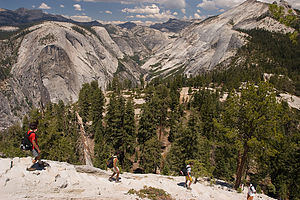 Lolo and boys descending Half Dome shoulder