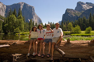 Gaidus family on log with El Capitan