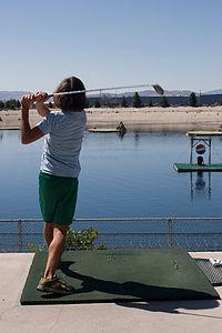 Andrew driving golf balls