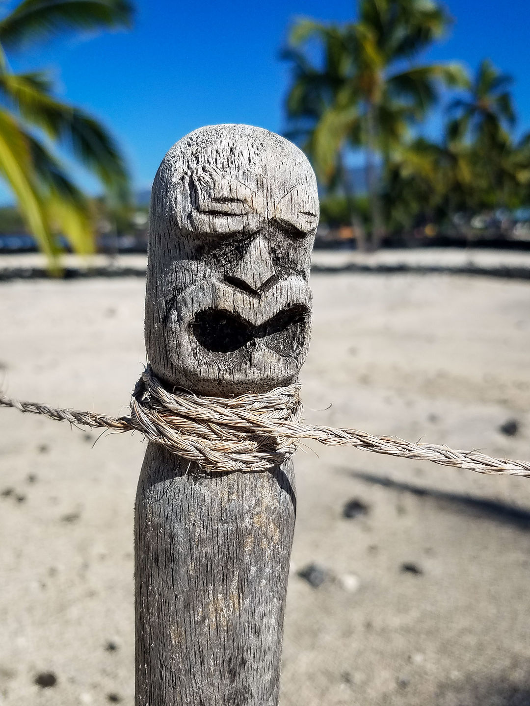Wood carving of a god in Pu'uhonua O Honaunau National Historical Park