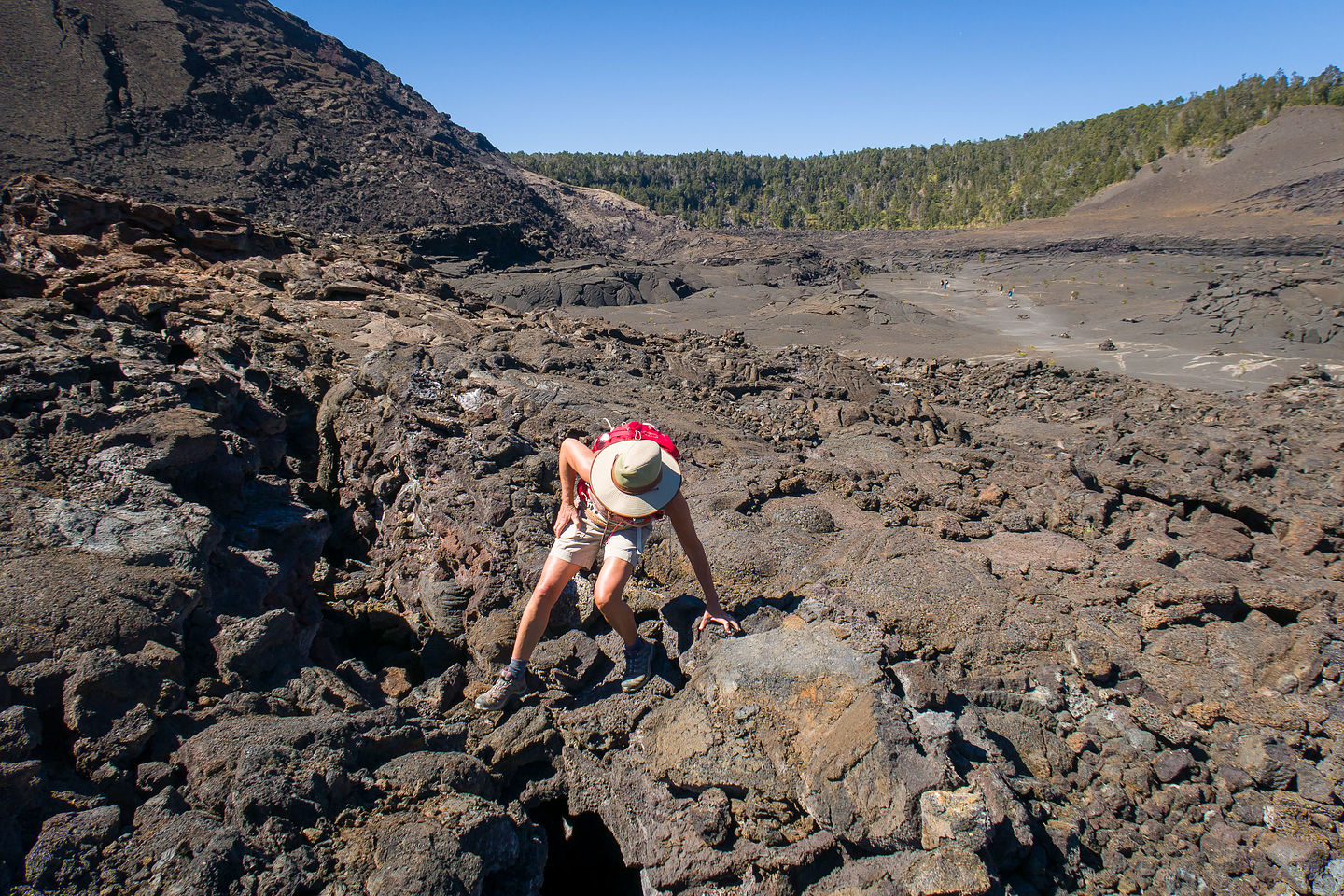 Lolo scrambling up to a Steam Vent in Kilauea Iki Crater
