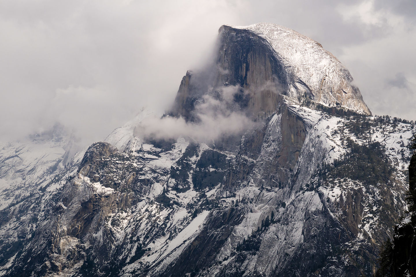 It's snowing on Half Dome!!