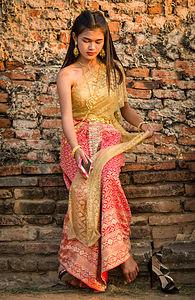 Traditional Thai dress at Chai Watthanaram Temple