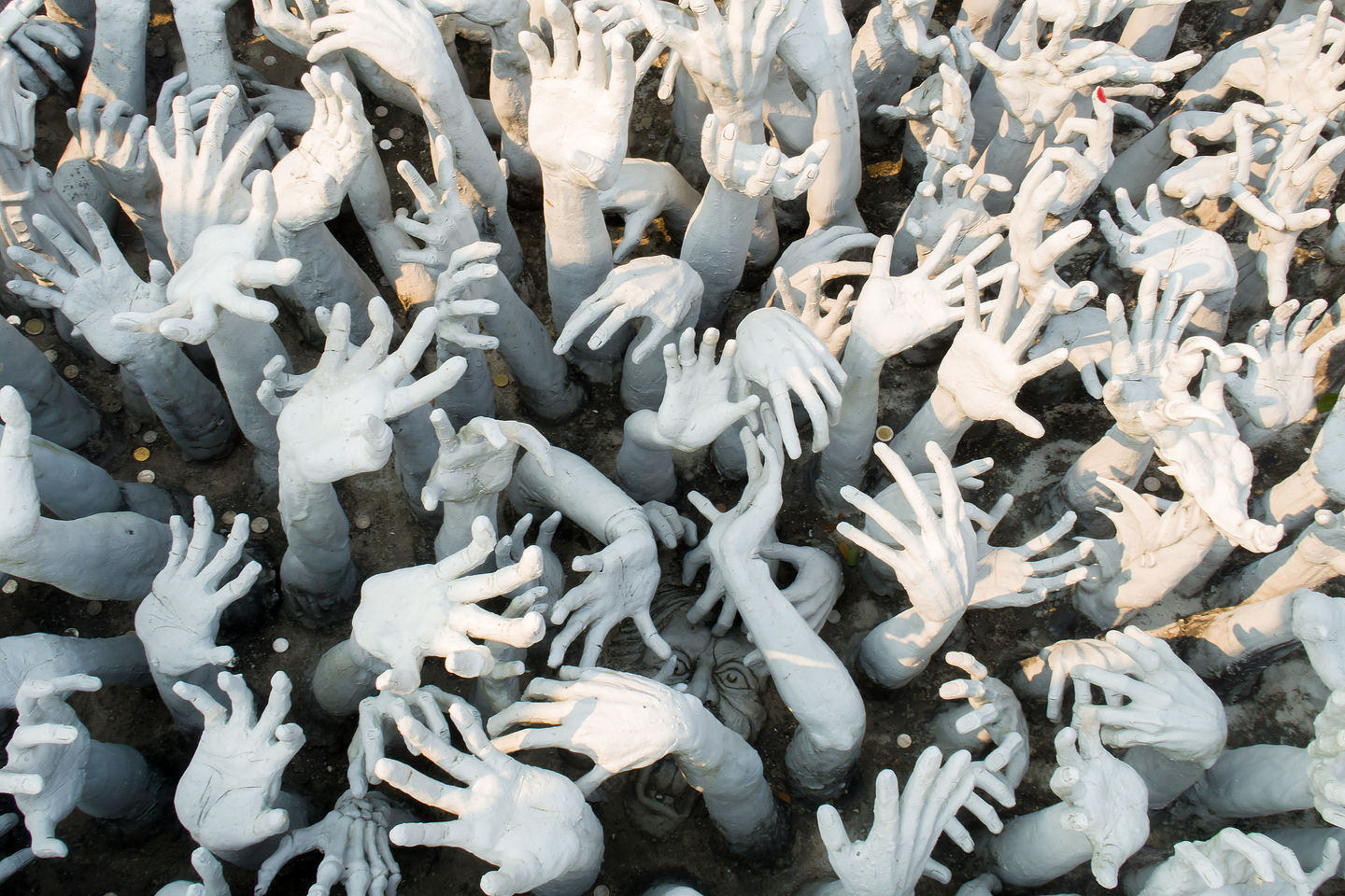 The beseeching hands of the suffering at the White Temple