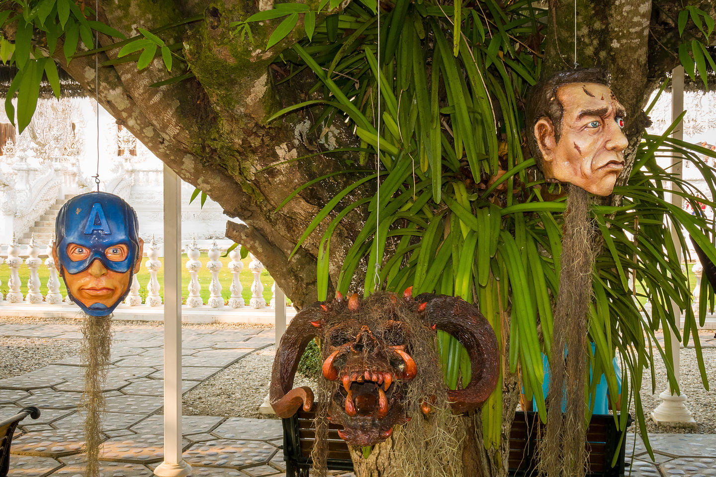 Creepy heads hanging from trees at the White Temple