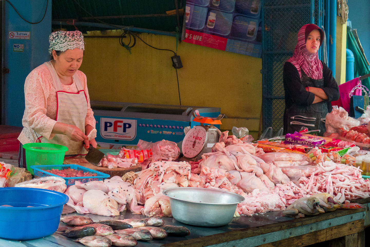 Chicken (with flies) at the Myanmar market