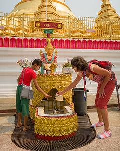 Lolo's little friend helping her through her Buddhist rituals