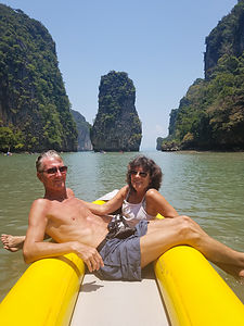 Enjoying being kayaked around beautiful Phang Nga Bay