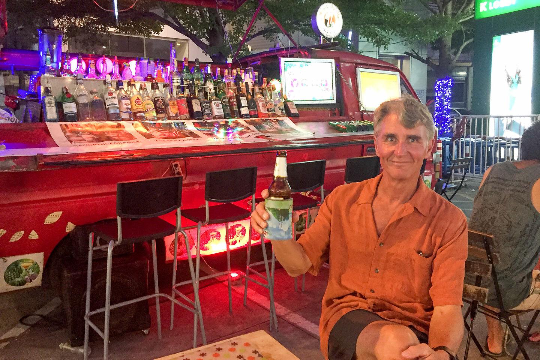 Herb enjoyinga beer at the Suvarnabhumi Night Market