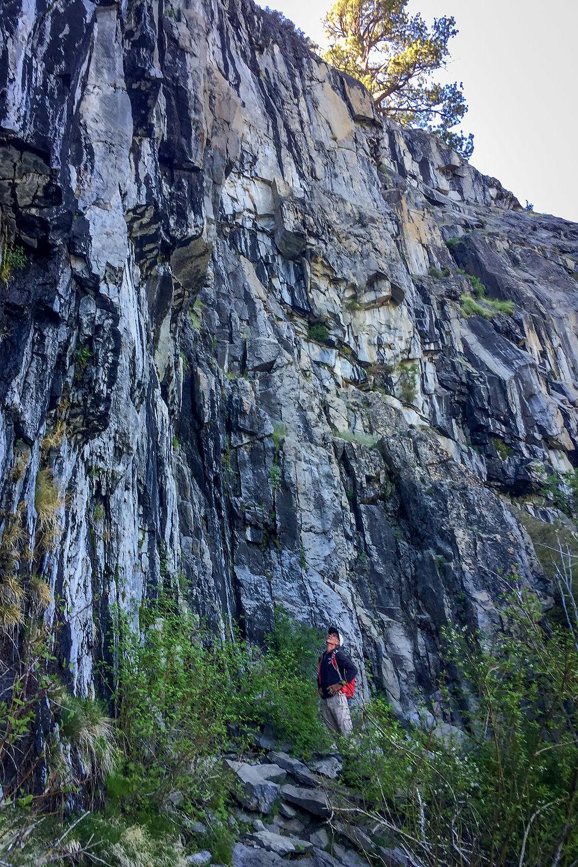 Herb contemplating Mayhem Cove climbing crag