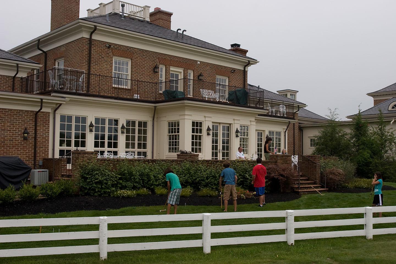 Gang playing croquet in the backyard
