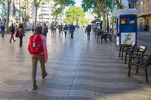 Lolo strolling along the wavy tile work of Las Ramblas