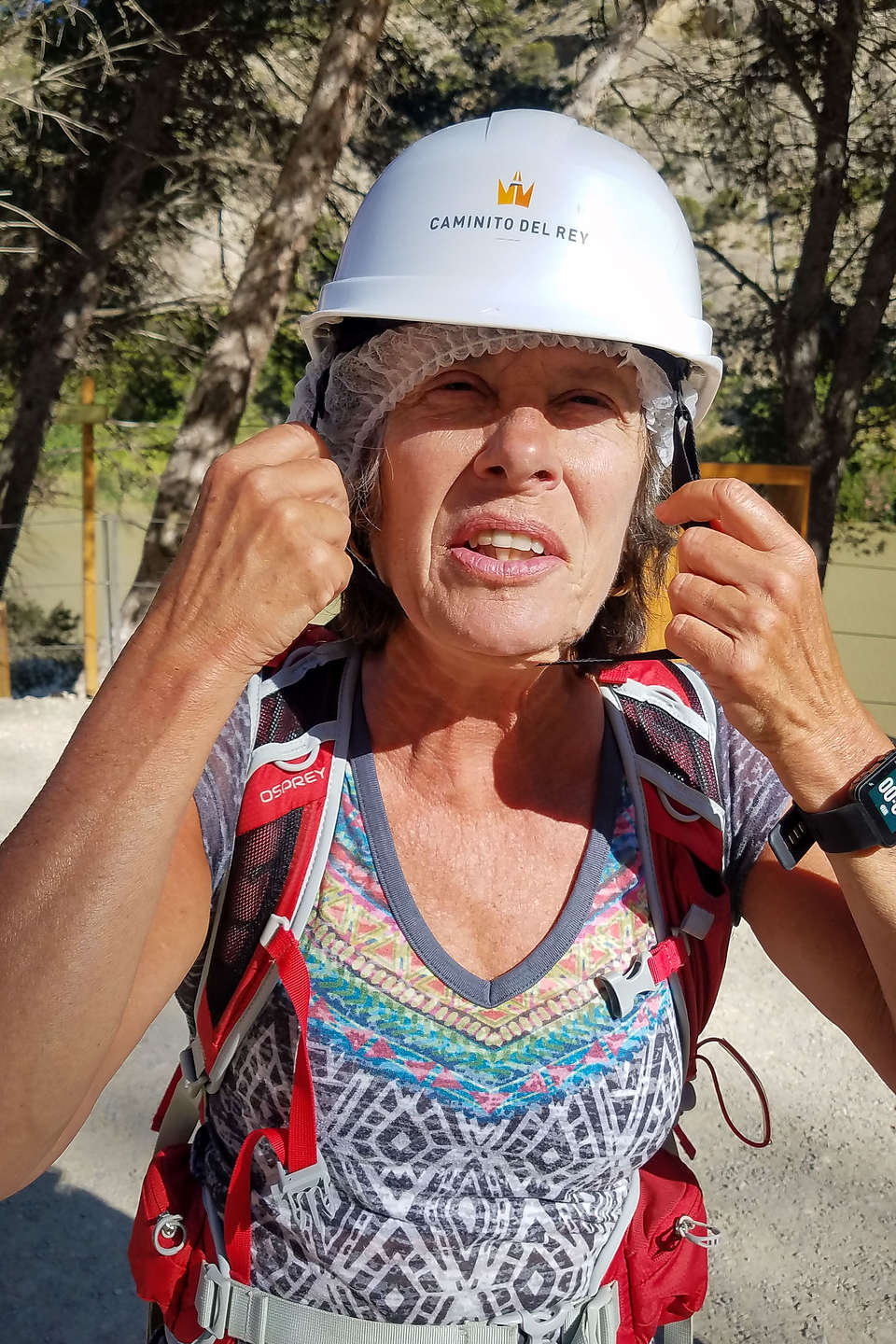 Lolo donning her hairnet and helmet in preparation for the Caminito del Rey