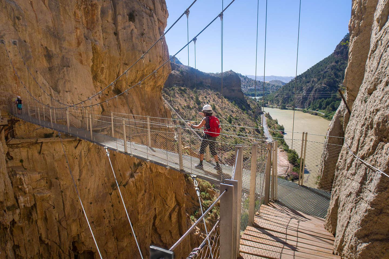 Lolo crossing over the windy suspension bridge
