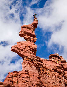 Climber atop the corkscrew summit of the Ancient Art formation