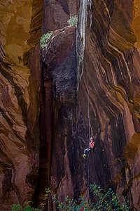 Rappeller descending from top of Morning Glory Natural Bridge