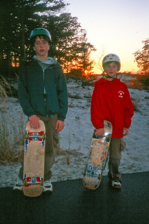Boys post skate boarding
