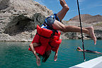 Andrew diving off boat with many preservers - TJG