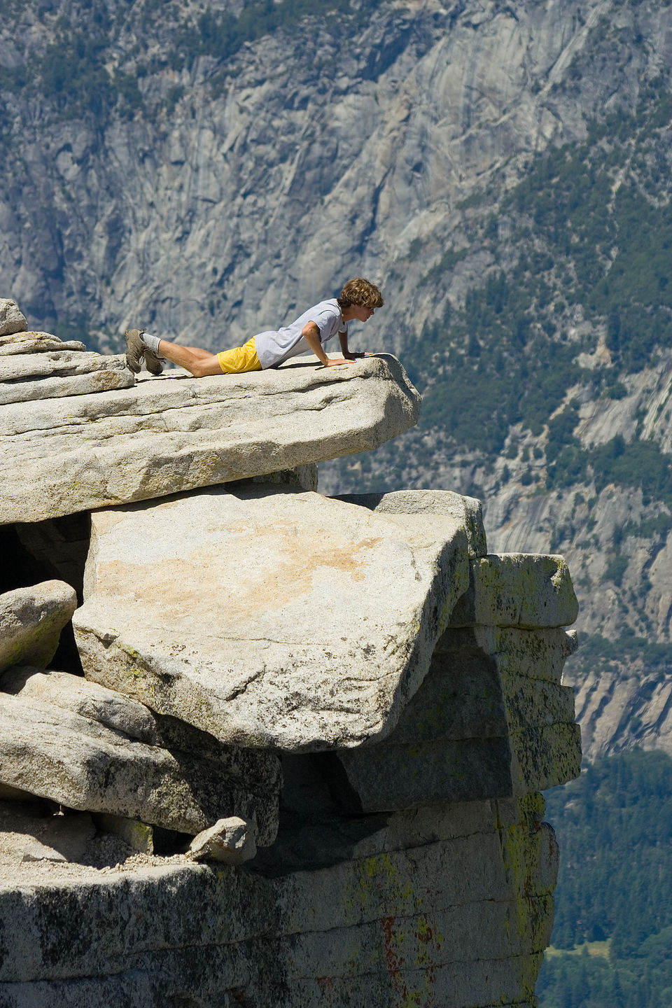 Tommy peering over Half Dome ledge - AJG