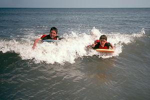 Boys boogie boarding Hunting Island
