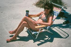 Lolo sun bathing on beach