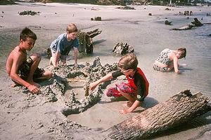 Kids making drip sand castles