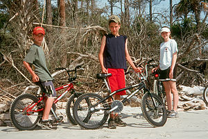 Boys and Whitney with bikes on beach
