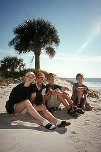 Kids under Palmetto Palm on beach