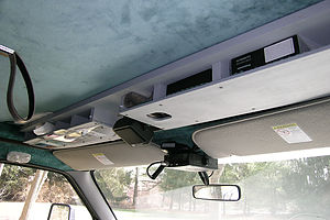 Overhead cab storage console