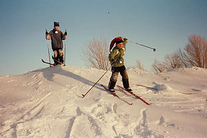 Boys XC skiing off-trail